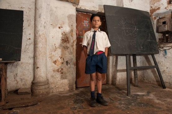 Scolaro in una scuola elementare di Varanasi